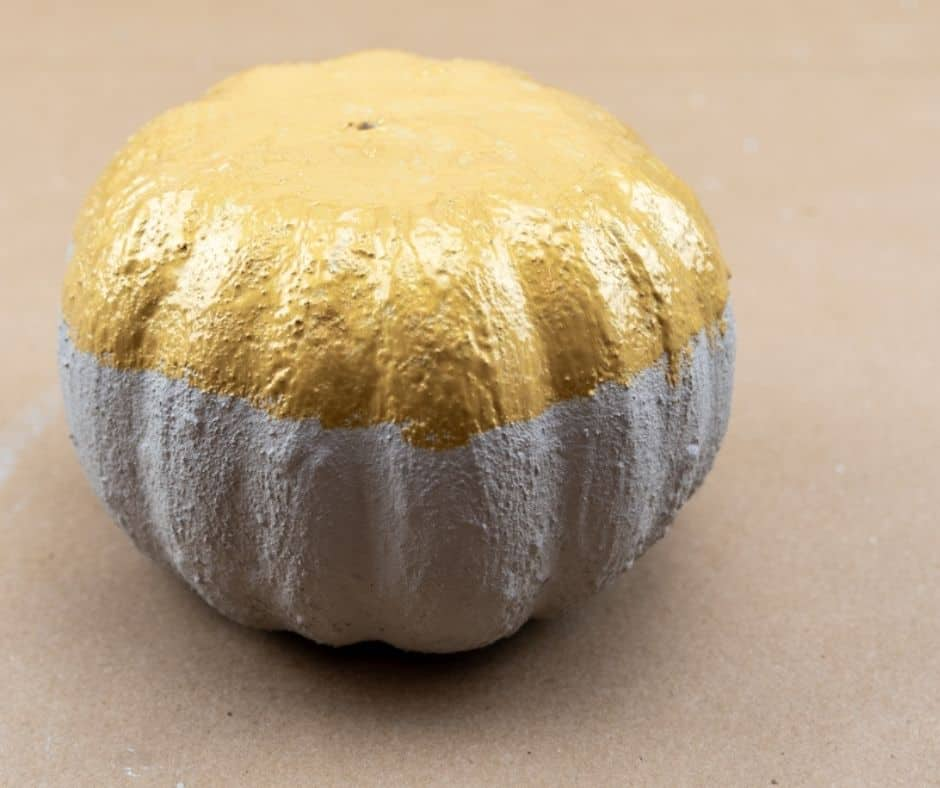 gold and concrete pumpkin drying