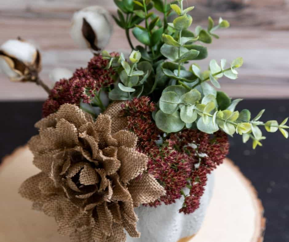 top view of gold and concrete pumpkin with flowers