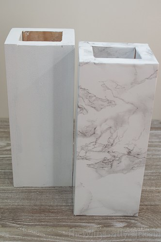 columns covered in marble adhesive paper
