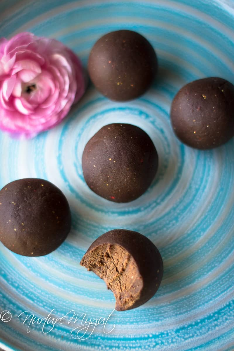 Picture of round chocolate covered balls, one with a bite missing