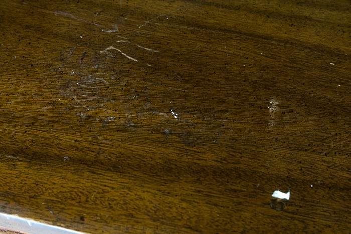 picture of dresser top showing scratches