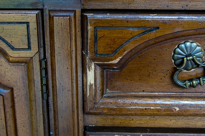 Picture showing damage on a wooden dresser drawer