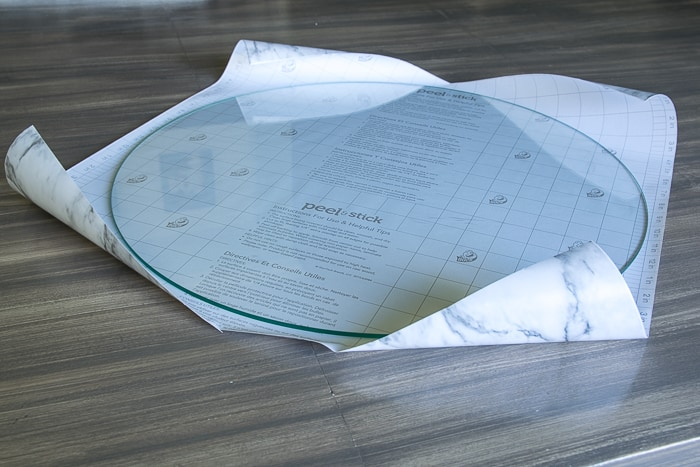 picture showing round glass top on shelf liner paper
