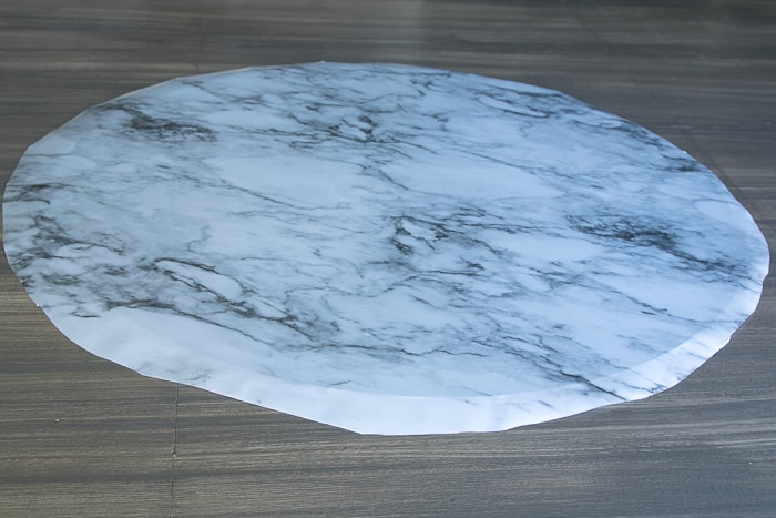 picture of round glass with marble adhesive shelf liner applied
