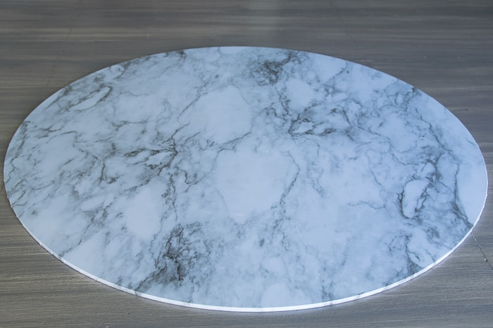 picture showing glass round completely covered in marble shelf liner paper