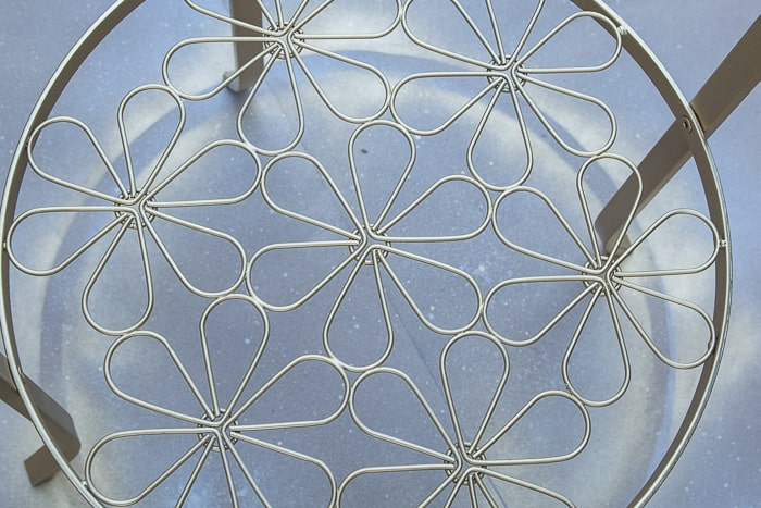 picture of spray painted floral element of round metal Ikea Klingsbo table