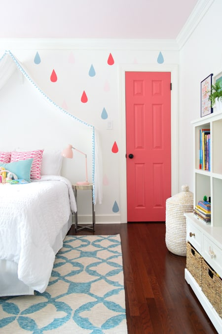 picture of a bedroom wall with rain drops and a pink door