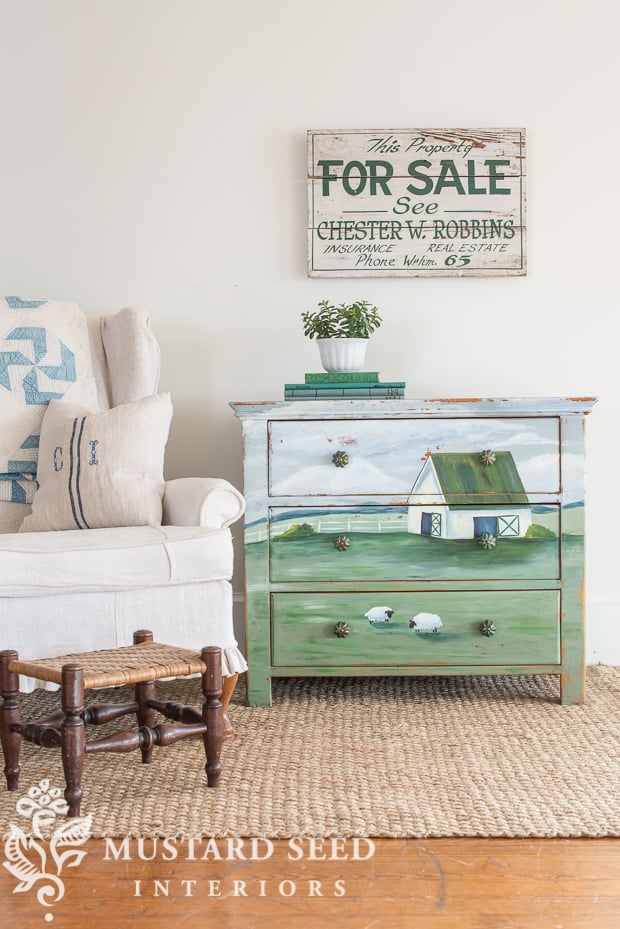 picture showing dresser painted with a farm landscape
