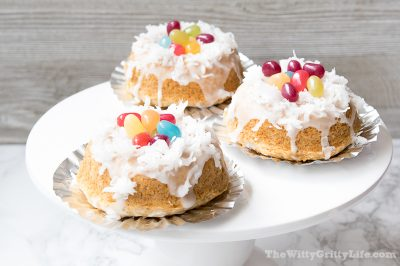 three easter bunny donut nests on a cakestand