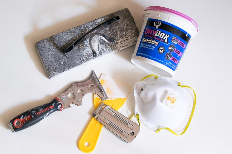 various tools and supplies for a DIY paint and prep job