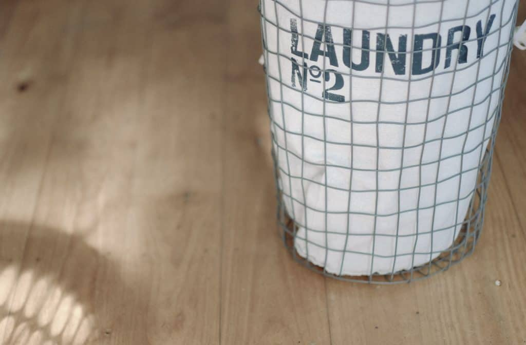 laundry basket on wood floor