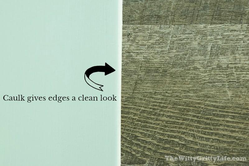 image showing caulk line along vinyl planks