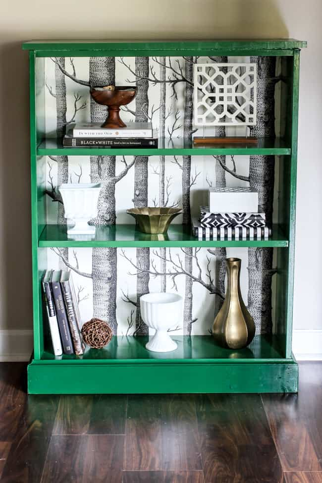 green book case with birch temporary wallpaper