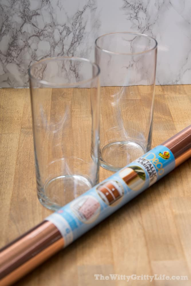 two glass cylinder vases with copper metallic adhesive foil