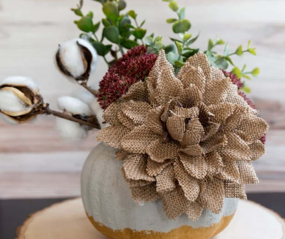 finished gold and concrete pumpkin planter
