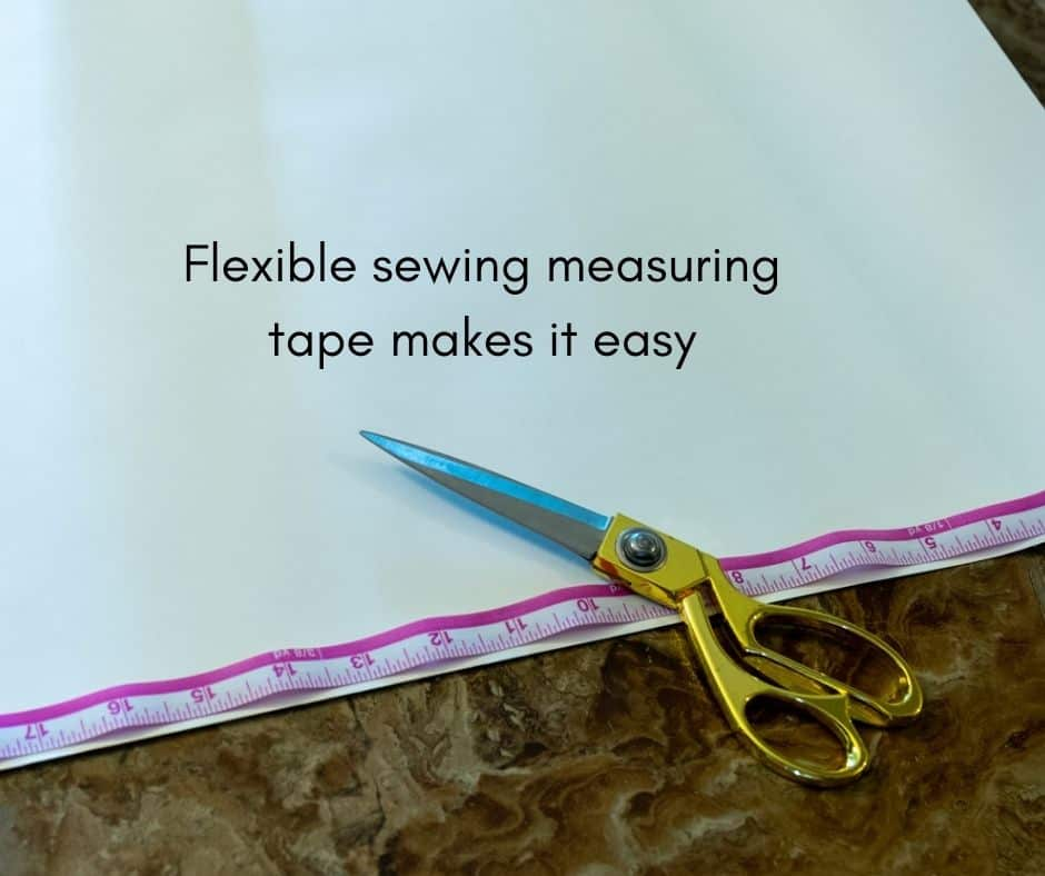 adhesive wall paper with scissors and measuring tape