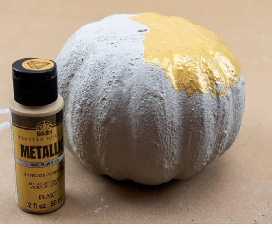 concrete pumpkin with gold paint