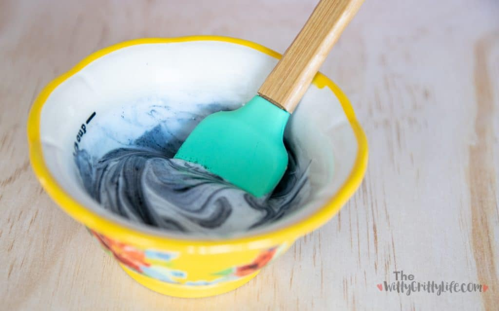ingredients for charcoal mask recipe mixed in a bowl