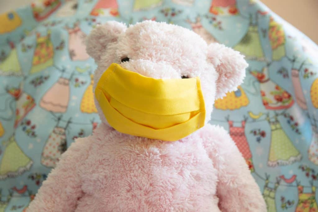 pink bear modeling yellow washable face mask for children