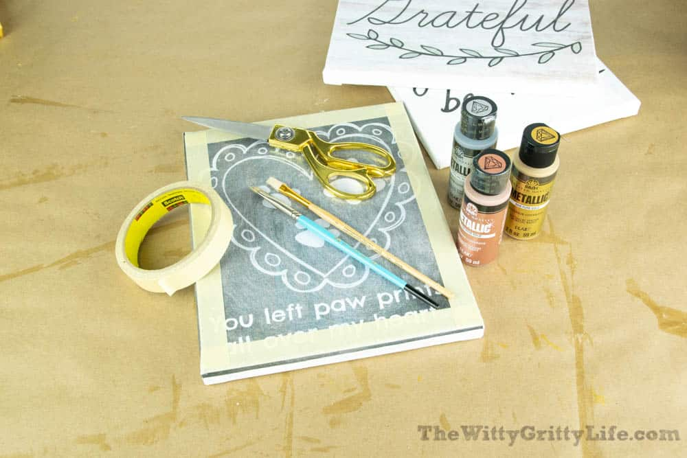Metallic acrylic paint and other supplies needed to finish diy wall signs with quotes