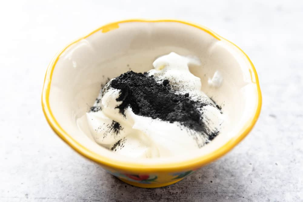 yogurt and charcoal in a bowl