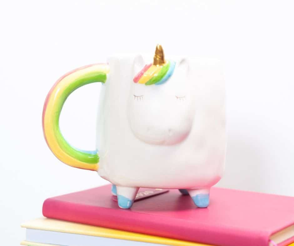 picture of unicorn mug on a stack of colorful books