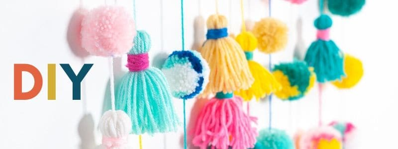 image showing colorful pompoms and multicolor letters spelling DIY