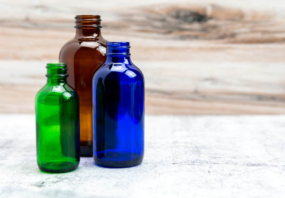 Brown, green and blue glass bottles