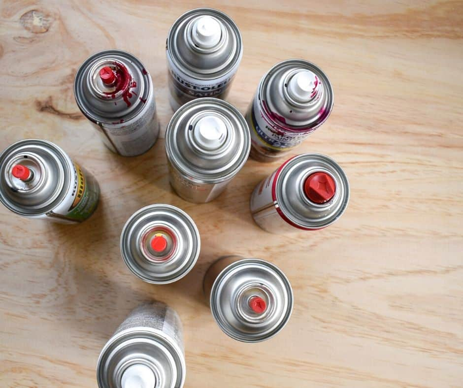 Image of several paint cans viewed from above