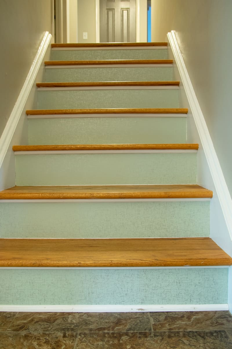 Picture after temporary wallpaper has been applied to all seven stair risers