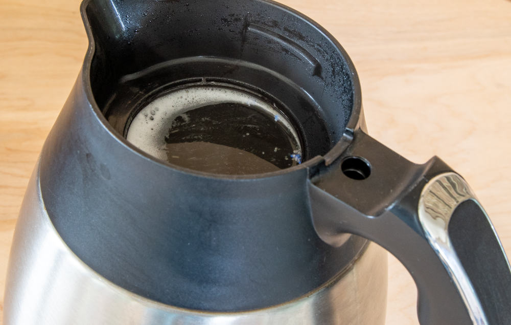 coffee pot with boiling water and dishwasher detergent