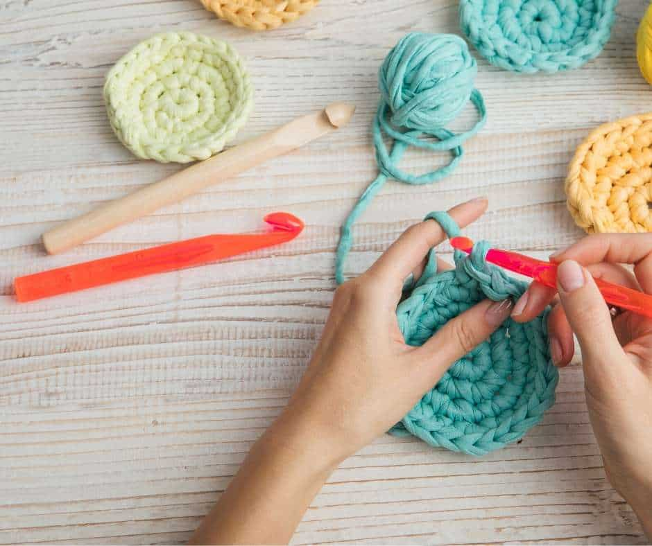 hands with yarn and crochet needles