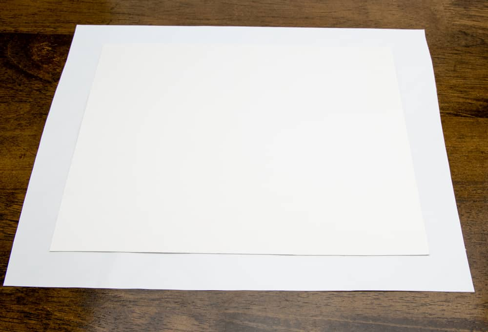 poster board on adhesive liner paper