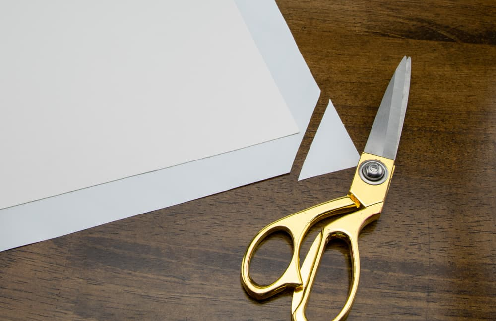 adhesive paper with one corner trimmed