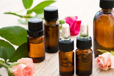 image showing essential oil bottles and flowers