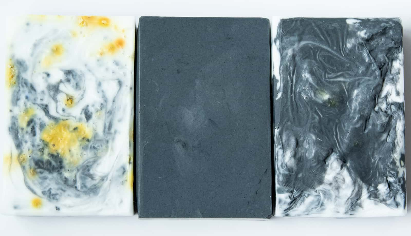 three finished examples of homemade charcoal soap