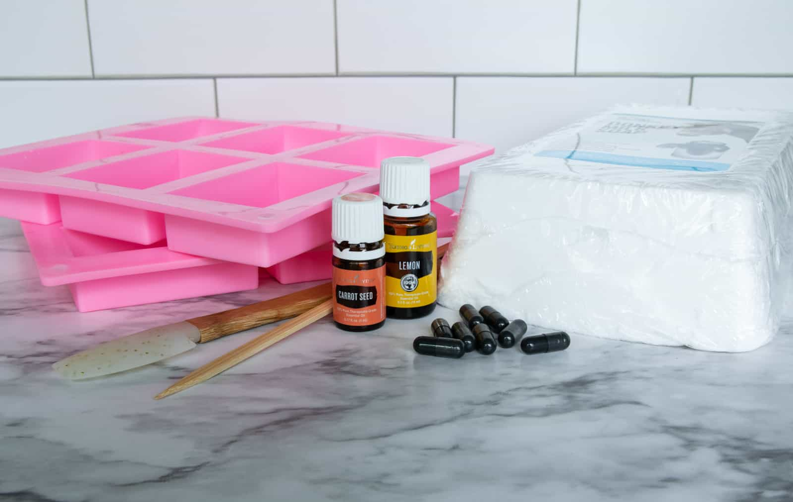 silicone soap molds, activated charcoal capsules, essential oils, tools and pour and melt soap block