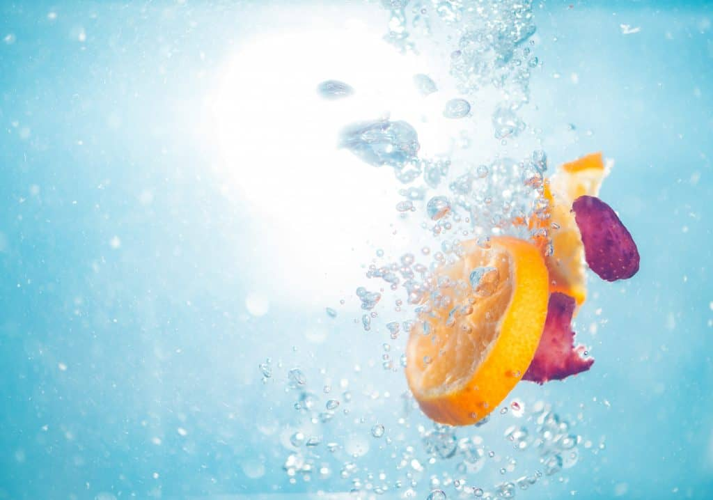 citrus fruits under water for homemade citrus cleaner