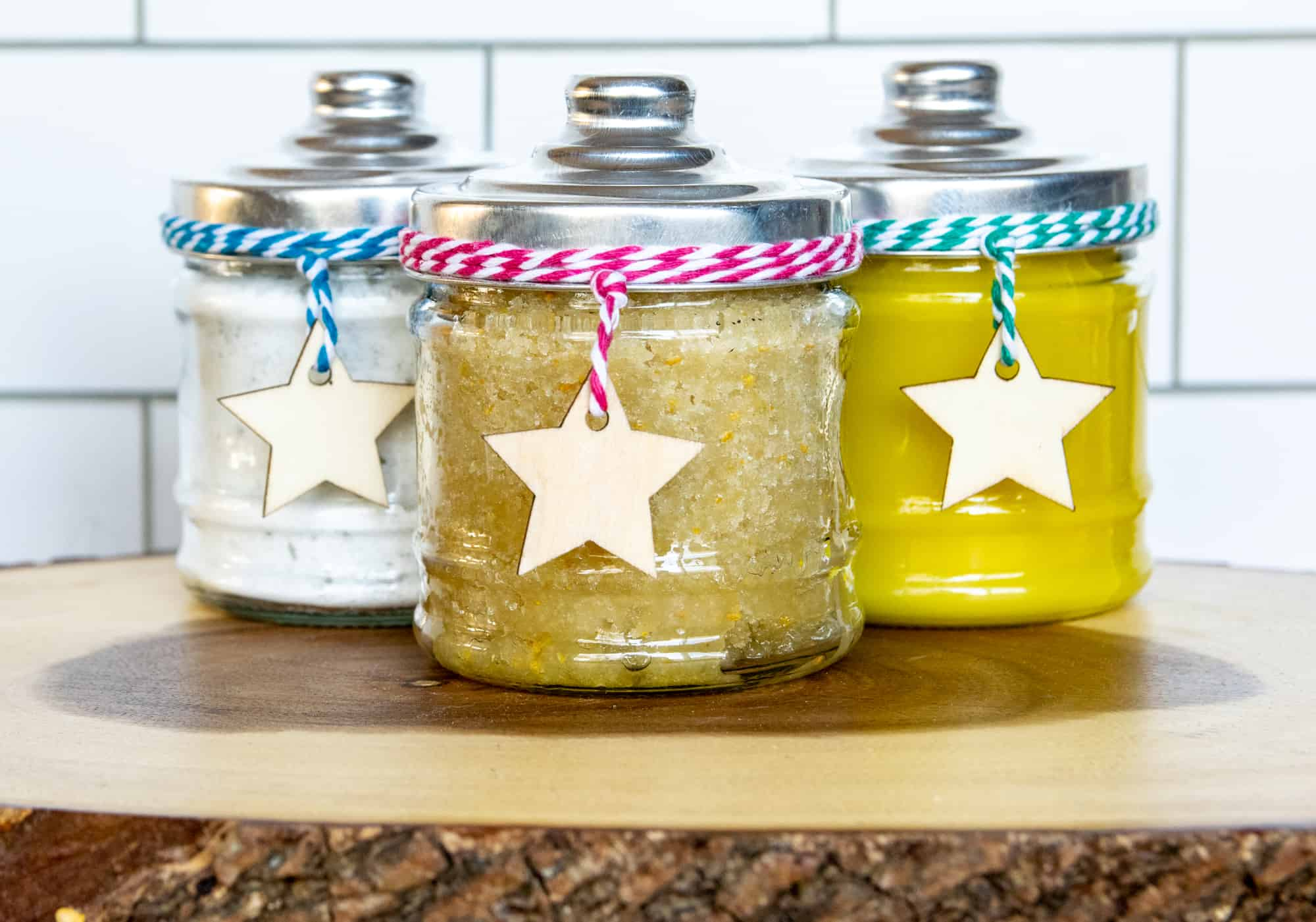 image showing 3 jars with ribbons and stars containing different body products