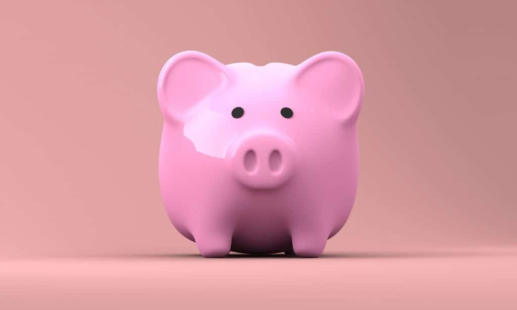 pink piggy bank for how to save even more money at dollar tree