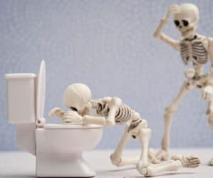 picture of skeleton throwing up in toilet