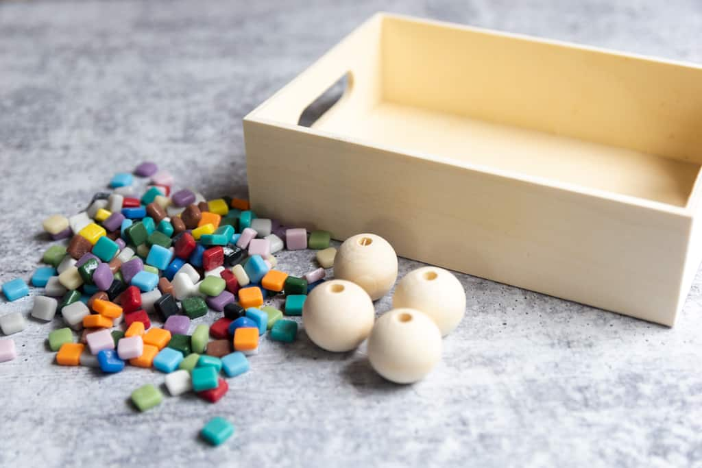 small tiles with large beads and wood tray