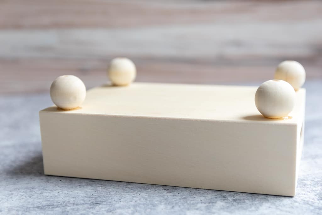 bead feet glued to bottom of tray