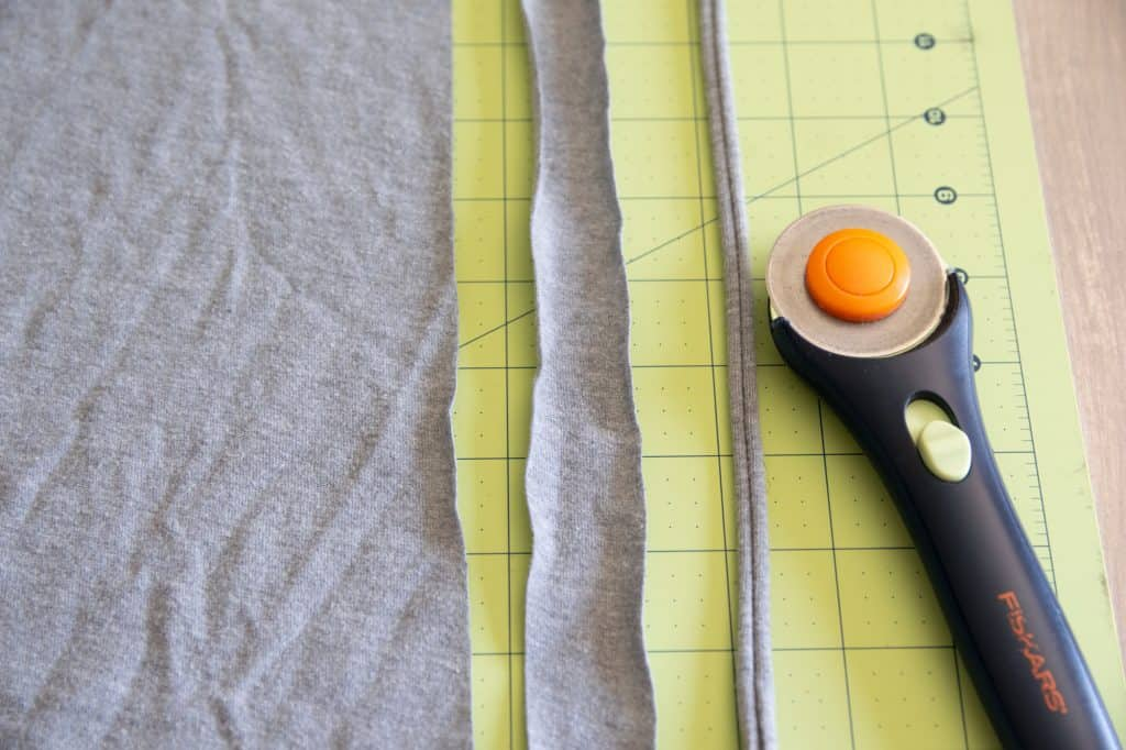 t shirt fabric cut into strips and rotary cutter