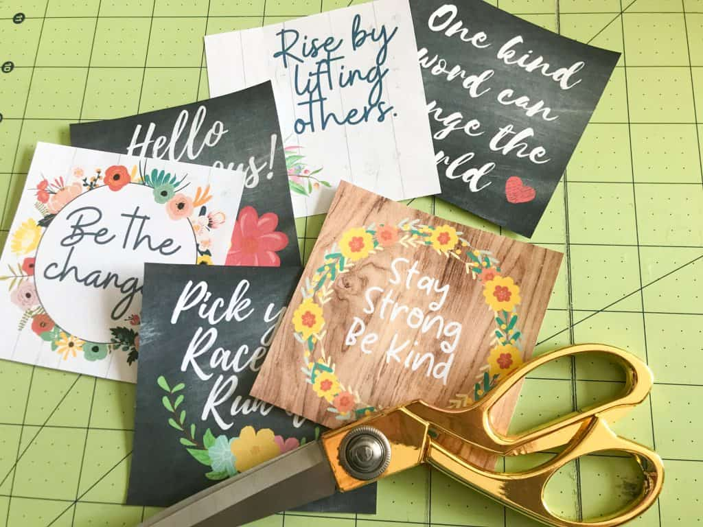 image of several graphic prints in various colors trimmed to size and a pair of scissors