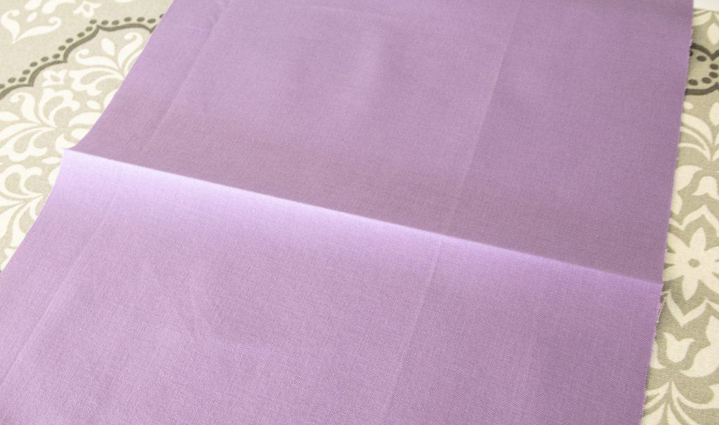 image showing fabric with pressed centerfold for washable face mask