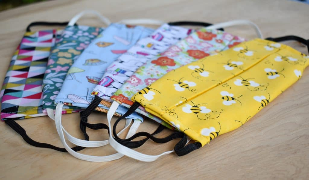 image of several washable cotton facemasks with filter pocket in various patterns and colors